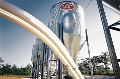 Feed silos with flex augers