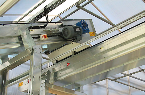 Belt conveyors with bottom cover