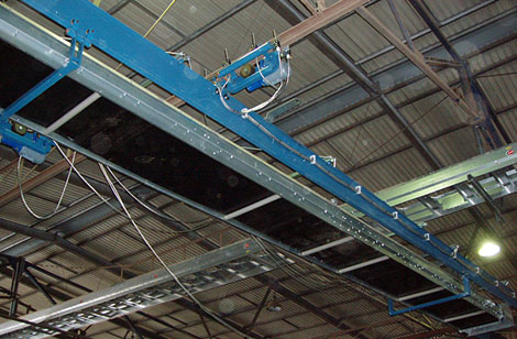 Central conveyor and side to side conveyor