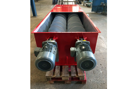 Twin discharge augers
