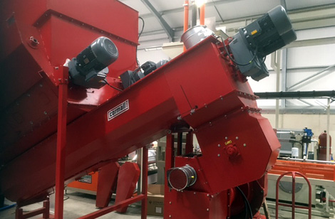 Twin discharge auger feeding hammer mill